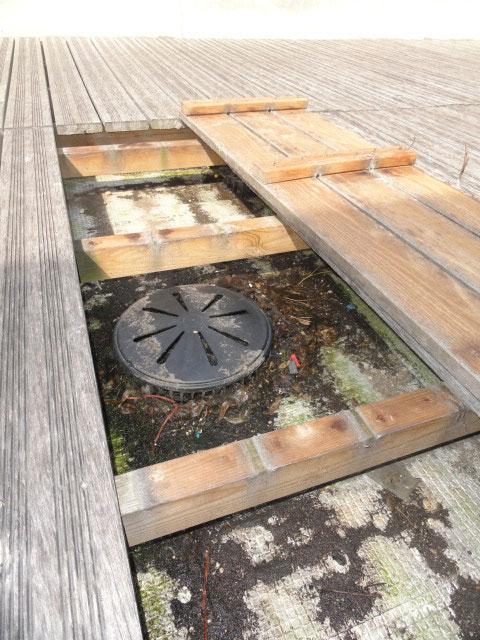 Obstruction sous platelage bois
